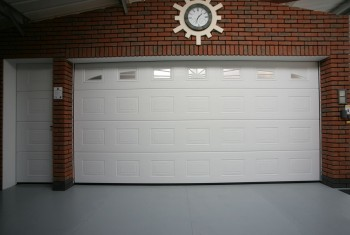 White garage door with side entrance