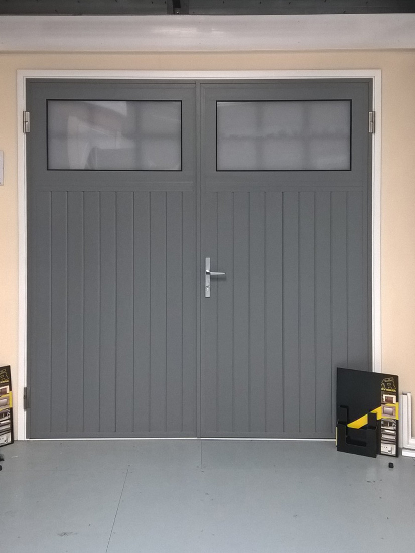 Swing doors or side hinged garage doors in mansfield for Garage side entry door