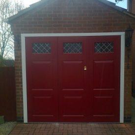 BGID-bi-fold side hinged garage door in ruby red