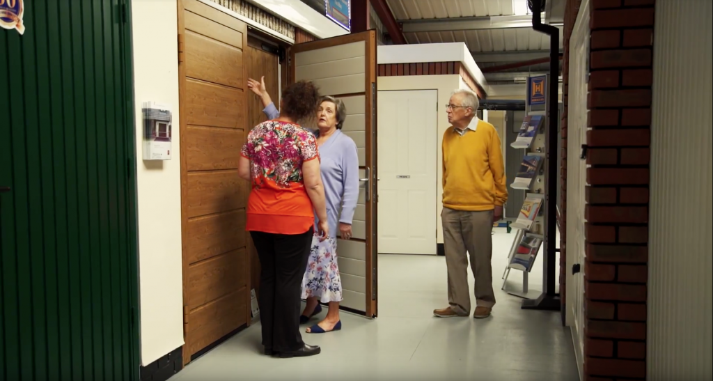 demonstrating door finishes to customers